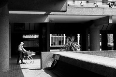 Man with plants in trolly - Barbican (jamiethompson01) Tags: london sony zeiss a7 mk2 mkii 55mm 18f barbican art gallery trees man trolly architecture british uk united kingdom brutalist chamberlin powellbon 1954 golden lane estate city sun summer may bank holiday weekend saturday plants life people space car classic bentley bike motorbikes graffiti east north
