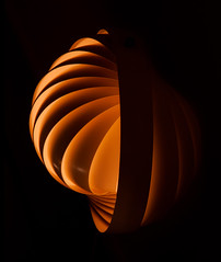 nautilus (Reflectory (Chris Brown) Away) Tags: abstract abstraction minimal minimalism nonobjective nopeople vertical portrait orange yellow black blackbackground curve curves spiral arcs round plastic sectional sphere reflectory