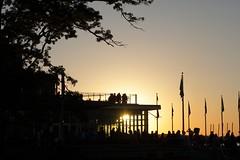 Terrace silhouettes (danielhast) Tags: madison wisconsin uwmadison memorial union terrace sunset silhouette people tree sky
