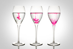 Steps of ink dissolution in water (iDesy) Tags: ink pink glasses goblet water dissolution step science physics color nature still life glass steps riflession white backgroung