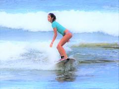 Honoli'i Paka Beach (thomasgorman1) Tags: surfer woman wave surfboard watersports hawaii sea ocean beach waves canon bright zoom zoomed colors honolii hilo hamakua coast