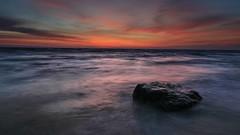 Sunrise at the beach of Bansin (venolab) Tags: longtimeexposure explodingcolors stone orangesky strand balticsea ostsee sonnenaufgang sonnenaufgangsbild bluehour beach sunrise