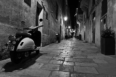 Malta Streets (Douguerreotype) Tags: people monochrome dark blackandwhite malta street mono lights city valletta night scooter bw urban bike moped