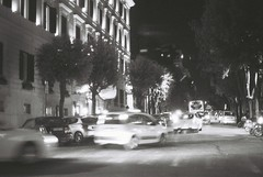 Roma (goodfella2459) Tags: nikon f4 af nikkor 50mm f14d lens ilford delta 400 35mm blackandwhite film analog night roma city street cars traffic building road rome italy lights bwfp manilovefilm