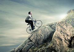 Fotolia_57994747_XS (cfdtfep) Tags: tired mountain business businessman work job occupation climb mounting ascent landscaped outdoor man bike bicycle pedal hard difficulty career concept effort sky nature challenge defiance competition light sun success win sport active force power impossible mission adventure search explore unknow caucasian grow