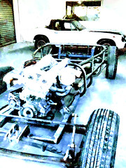 The Carcass (Steve Taylor (Photography)) Tags: frame engine chassis wheels tyres garage repair rebuild tread carcass digitalart black blue green metal rubber newzealand nz southisland canterbury christchurch city perspective texture car automobile auto motor workshop