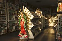 La Virgen (GC_Dean) Tags: phoenix arizona north19thavenue yerberia storeinterior shelves retail statue shrine lavirgen virginofguadalupe street emptiness mundane city cityscape urban urbanlandscape sociallandscape space colors color colours structure building shadows