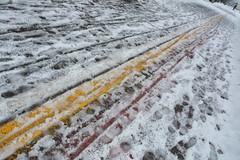 Impronte di vita - Imprints of life. (sinetempore) Tags: neve snow ghiaccio ice lineecolorate coloredlines impronte fingerprints freddo cold inverno winter pavia naviglio lineagialla linearossa yellowline redline improntedivita imprintsoflife uomo man uomoconombrello umbrella street
