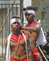 Getting Ready (1X7A4741b) (Dennis Candy) Tags: srilanka ceylon serendip kandy esala day perahera pageant procession parade festival religion street buddhism culture tradition heritage dancer boy youth red headgear help white