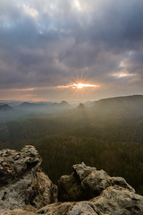 Just for a second (derliebewolf) Tags: sunshine storm stormy sunrise sunrays easter hiking saxony saxonswitzerland nationalpark backcountry backpacking mountains fog mist goldenhour gleitmannshorn cliff travel spring forest clouds landscape portrait portraitorientation filter flare sunstar earlymorning earlybird