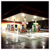 Gas station at closing (f l a m i n g o) Tags: canopy lights night station gas pavement cement closing monday 2018 26th march wet snow hipstamatic