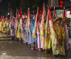 Village Life: Mazu Festival (allentimothy1947) Tags: shilou taiwan yunlincounty mazufestival tao festival silou women march parade rain street tradition religion hats raincoats yellow night flags