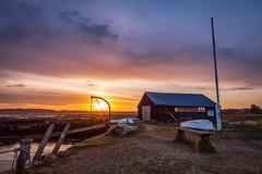 Early Sun (Speedy349) Tags: newtown isleofwight sunrise boathouse yachts glow clouds sun