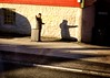 Bus stop in the sun (halifaxlight) Tags: norway hordaland bergen busstop man suitcase sunny shadow road building hailing window
