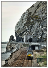 Between a rock and a wet place (david.hayes77) Tags: drs directrailservices class68 vossloh 68023 6d43 northwales wales conwybay penmaenbach dwygfylchi 2018 nuclearflasks tunnel a55 northwalesexpressway gorse rock seashore coast conwy freight cargo achilles cat 68001 evolution