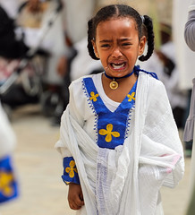The challenge of crying people (ybiberman) Tags: israel jerusalem oldcity alquds christianquarter churchoftheholysepulchre deirelsultan palmsunday girl cry braids ethiopian necklace earring white portrait candid streetphotography pain people