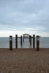 pier (curly_em) Tags: beach brighton eastsussex seaside sea sky clouds grey holiday coat