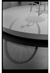 P61-2018-025 (lianefinch) Tags: argentique argentic analogique analog monochrome blackandwhite blackwhite bw noirblanc noiretblanc nb graphic graphique marcel duchamp roue de bicyclette ombres shadows museum moma exhibition exposition musée bicycle tabouret paris