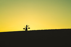 Silhouettes of women standing in the desert of Vietnam (Patrick Foto ;)) Tags: aodai alone background beautiful beauty black concept copyspace desert dunes dusk evening female girl human lady landscape morning mountain mui natural nature ne outdoor people person sand silhouette sky standing summer sun sunrise sunset traditional travel twilight vietnam view walk white woman women yellow young thànhphốphanthiết bìnhthuận vn