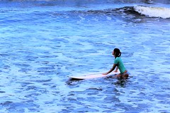 Honoli'i Paka (thomasgorman1) Tags: surfer girl woman beach surfing nikon watersports island hilo recreation honolii sea shore ocean tide water wave waves