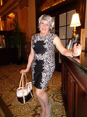Hanging Out At The Concierge's Desk While The Actual Concierge--Helga--Is Otherwise Occupied (Laurette Victoria) Tags: hotel milwaukee pfisterhotel dress bw woman silver laurette