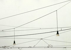 urban jungle (Rino Alessandrini) Tags: cable powerline electricity architecture outdoors steelcable urbanscene nopeople wire cables wires lianes street lamps urban abstract minimalist monochrome lines traces interweaving cavi fili liane elettricita lampioni urbano astratto minimalista monocromo linee traccie intrecci