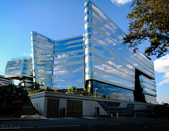 The Sasol Building in All its Glory! (Raphael de Kadt) Tags: sandton johannesburg southafrica africa masterpiece clouds reflections blue silver grey tree xt2 fujifilm fujinonxf1024mm wideangle