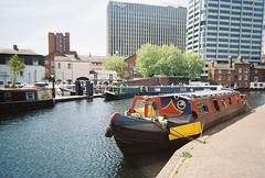 lsuc - brindleyplace (johnnytakespictures) Tags: lomo lomography lomographycn400 film analogue 35mm disposable camera simpleuse colour birmingham westmidlands canal river stream water boat ship sail sailing longboat narrowboat barge dock docks brindleyplace summer sun sunshine city old abandoned dilapidated rusty moor moored