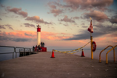 Lighthouse (Stefen Acepcion) Tags: canada lighthouse sky golden hour bluesky clouds concrete red flag yellow ontario lake afternoon