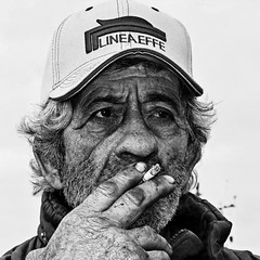 C'è un sacco di gente per la quale una sigaretta è l'unica vacanza che possono permettersi.-There are a lot of people for whom a cigarette is the only holiday they can afford. Trey Parker (Corrado Tripicchio) Tags: people poverty bw smoker man face strong contrast