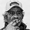C'è un sacco di gente per la quale una sigaretta è l'unica vacanza che possono permettersi.-There are a lot of people for whom a cigarette is the only holiday they can afford. Trey Parker (Corrado Tripicchio) Tags: people poverty bw smoker man face strong contrast