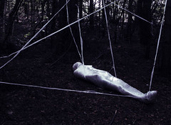 Cocoon (Ridgway Imagery) Tags: fineartphotography fineartphotographer fineartportrait fineart surrealart surrealphotography conceptualart conceptualphotography performancephotography performanceart surreal conceptual constructednarrative constructed narrative story plot tale woodland outdoor forest trees park naturereserve clingfilm cocoon chrysalis subject body form wrappedup props costumes slimey shiny ridgwayimagery atmospheric dark creepy student degree pastwork oldwork archive