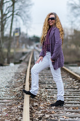 Keeping Track of Wanda (tquist24) Tags: elkhart fashion indiana nikon nikond5300 wanda bokeh boots cloudy curls cute geotagged girl hair leaves model person portrait pretty purple rail railroad rails sky smile sunglasses tracks traintracks tree trees woman unitedstates