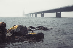 Water under the bridge. (A.Dissing) Tags: storebæltsbroen bridge water stone mist fog white dark black art light contrast a7 a7ii a7m2 sony anders dissing masterpiece super detail fantastic good positive photo pixel mm creative beautiful color composition moment europe artistic other danish denmark danmark different exposure enjoy young unique weather scene awesome dope angle perfect perspective interesting architecture