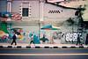 (Hem.Odd) Tags: canonae1program street expired pedestrians wallpainting imationscotch100 people malaysia kualalumpur