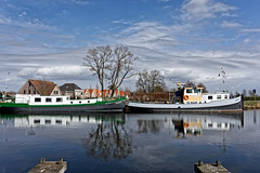 Cloudy Sky And Deep Reflections (Alfred Grupstra) Tags: water nauticalvessel house outdoors reflection architecture netherlands buildingexterior builtstructure harbor urbanscene tree river nature sky blue winter lake colorimage canal clouds