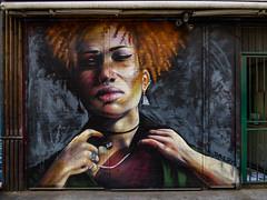 The Depth of Dreph (Steve Taylor (Photography)) Tags: dreph headphones frizzy nosering freckles earrings art graffiti mural streetart portrait calm woman lady uk gb england greatbritain unitedkingdom london