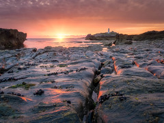 Godrevy Sunset (Timothy Gilbert) Tags: lighthouse wideangle sunset godrevy panasonic boulders rocks hdr gwithian m43 microfourthirds microfournerds lumix panasonic1235mmf28x cornwall gx7 coast