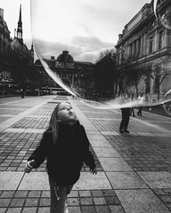 Urban magic~ Paris (~mimo~) Tags: photography city europe urban child blackandwhite girl bubble street france paris