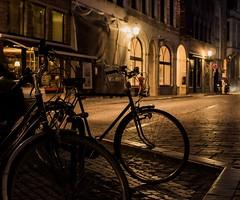 NIght Bikes (absoluteforecast) Tags: belgium bruges night bikes silhouette streets cobblestone light olympus sigma