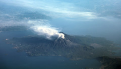 Sakurajima Volcano, Kagoshima, Japan - errupting again! (Jaws300) Tags: flyingscenery fromabove canon5d canon eos 5d kagoshima sakurajima volcano eruption erupting ash volcanic volcanicash japan a300600 a300 airbus air leaves changing fall colors colours trees tree hills hill mountains mountain morning scenery flying aloft airborne from above landscape aerial island islandvolcano kagoshimabay bay ashcloud smoke smoking huffing puffing blowing mt ontake mtontake mtsakurajima sky water airplane