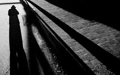 Lurking in the Shadows (Jon Scherff) Tags: shadow street noir wideangle blackwhite nikond810 monochrome