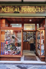 Medical Products (Douguerreotype) Tags: people city street shop buildings window malta architecture valletta urban door store
