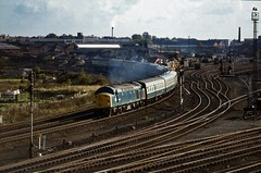 Class 40 no. 40027 PARTHIA @ York 20/10/1979 [slide 7926] (graeme9022) Tags: footex whistler type 4 1coco1 diesel english electric locomotive engine british rail railways br blue plain corporate standard livery north east england northern eastern region yorkshire 1970s uk train clifton sidings passenger transport transportation travel semaphore signal curve