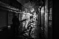 Raindrops keep falling on my head / trying to focus (Özgür Gürgey) Tags: 2018 35mm bw d750 darkcity nikon samyang blur dark evening grainy lowlight people rain reflection silhouettes street istanbul