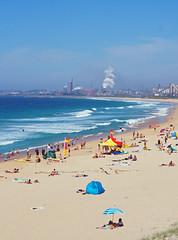 City Beach (Kaptain Kobold) Tags: kaptainkobold beach wollongong nsw australia easter weekend cross seaweed people tent factory works imdustry city seascape ocean sea steam spring