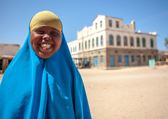 Smiling somali girl  in front of  a former ottoman empire house, North-Western province, Berbera, Somaliland (Eric Lafforgue) Tags: africa africanethnicity ancient architecture barbara berbera buildingexterior buildings child colonial developingcountry eastafrica female girl girls history horizontal hornofafrica house islam lifestyle lookingatcamera muslim onechildonly onegirlonly oneperson ottoman outdoors portrait smile smiling soma4132 somalia somaliland town traditionalclothing waistup northwesternprovince