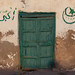 Green wooden door of an old house, North-Western province, Berbera, Somaliland
