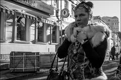 4_DSC5161 (dmitryzhkov) Tags: street moscow russia life human monochrome reportage social public urban city photojournalism streetphotography documentary people bw dmitryryzhkov blackandwhite everyday candid stranger conversation speak face streetportrait portrait glasses spectacles walk pedestrian walker outdoor passerby phonenation phone pretty woman shadows lights