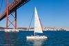 25th of April Bridge (ericvaandering) Tags: transportation water river structure structuresarchitecture bridge sailboat bywater sailingboat almada portugal pt